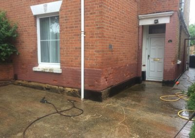 Textured coating concrete render causing damp and brick erosion