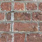 damage to bricks caused by sandblasting